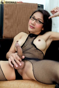 horny asian ladyboy in glasses wanks off